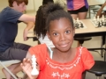 chess-scholar-holds-up-her-favorite-piece