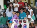 Brenden with SPFS scholars and Enrichment Instructor Donna Emerson showing off their paper mache creations!