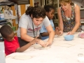 volunteer-gwen-orland-helps-make-ceramic-masks-at-the-jcc-ceramic-studio