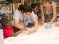 volunteer-gwen-orland-helps-make-ceramic-masks-at-the-jcc-ceramic-studio